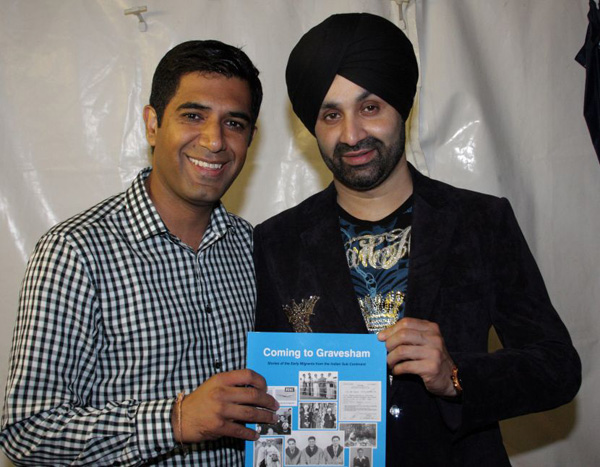 Gurvinder Sandher presenting copy of Coming to Gravesham to Sukshinder Shinda